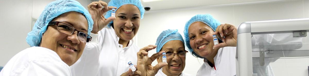 slider-mujeres-en-etiquetado-planta-vacunas-espromed-min